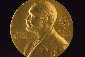 Medal for the Nobel Prize for Physics, awarded to British physicist George Paget Thomson (1892-1975) in 1937. The design shows a relief profile of Alfred Nobel, designed and signed by Erik Lindberg in 1902. The prize was awarded by the Nobel Institute, Stockholm, Sweden, and shared by Thomson with Clinton Joseph Davisson USA, Ôfor their experimental discovery of the diffraction of electrons by crystalsÕ.